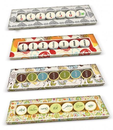 מארז שוקולד שפע ברכות המכיל 7 מטבעות שוקולד ממותגות